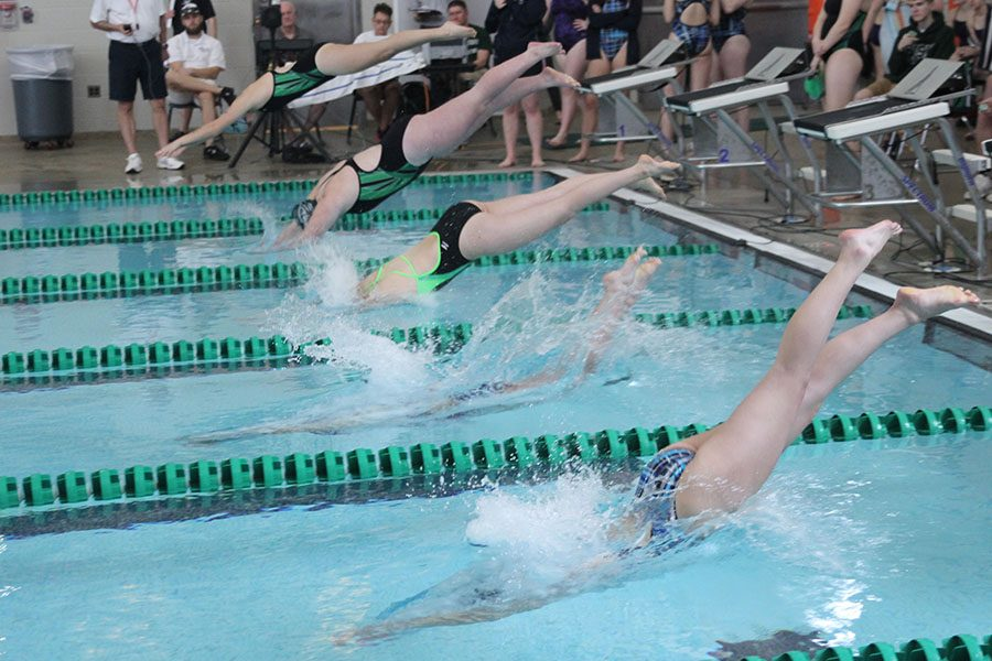Swimmers+dive+into+the+water+during+the+Blue+Valley+South+West+invitational+on+Saturday%2C+April+8.+The+girls+swim+team+finished+fourth+overall+with+a+total+of+168+points.
