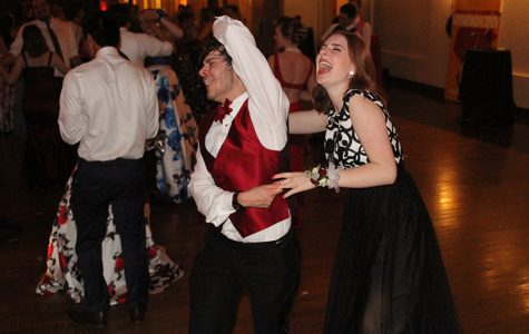 Junior Caroline Gambill dances with her date at prom on Saturday, April 29.