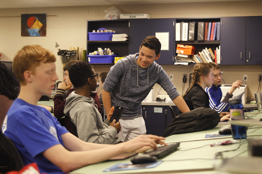 After completing his own project, sophomore Eric Schanker gives advice to other students.