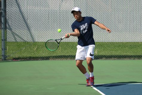 Running forward, senior Parker Billings prepares to hit the ball across the court on Wednesday, April 19.