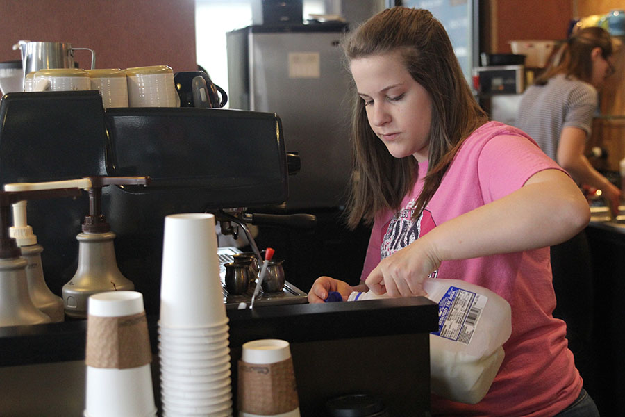 While working a shift at Country Club Cafe, senior Kristen Schau makes a specialty espresso drink for a customer on Sunday, March 26