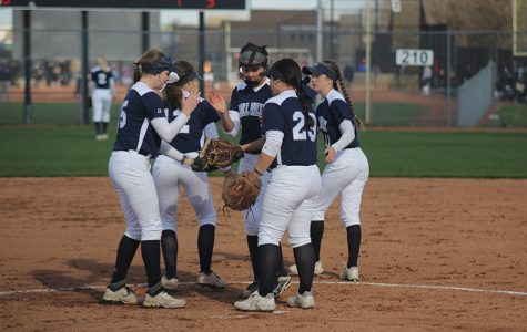 The team does a handshake after a group huddle on Thursday, April 6. The Jags fell in the first game against the Blue Valley Tigers 7-4 but came back to win the second game 12-1.