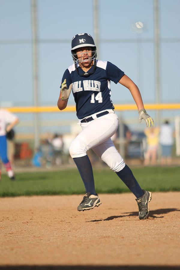 Freshman+Lauren+Florez+runs+from+second+base.