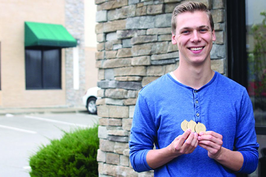 After competing for four years in diving, senior Mitch Willoughby has won three medals at state including a first place finish this year.