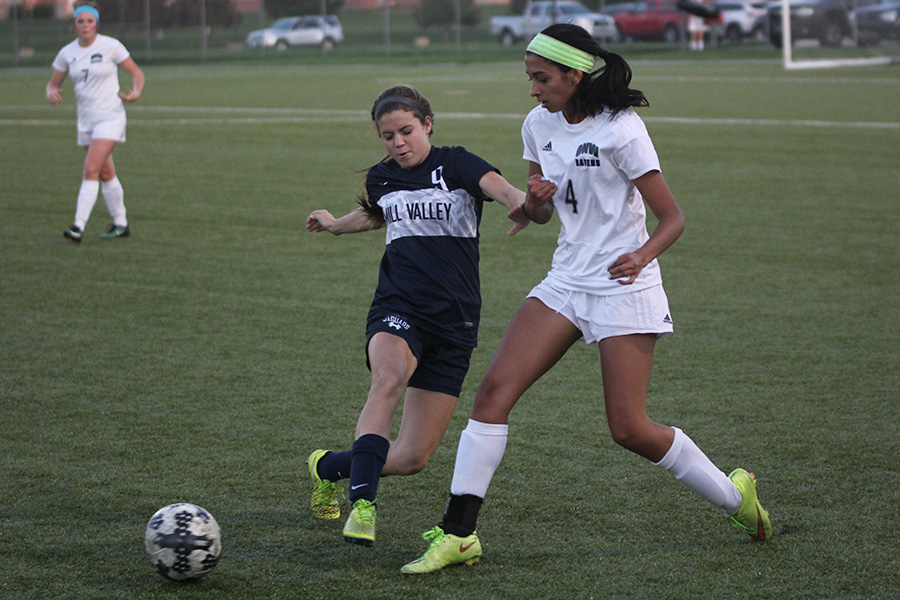 Sophomore Lexi Crocker defends a Raven player.