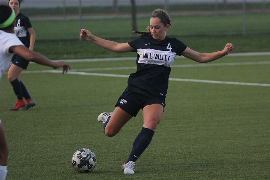 After setting up the ball, freshman Ella Shurley passes it to a teammate.