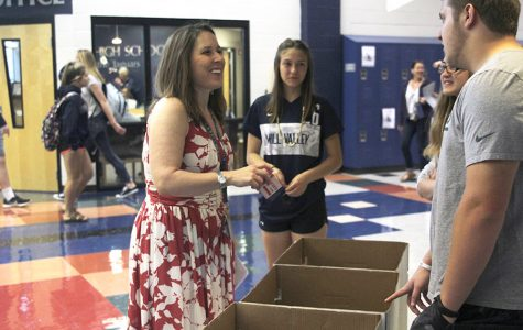 Donating to the Noah's Bandage Project drive, Social Studies teacher Angie DalBello smiles as she chats with Junior Preston Cole on Friday, April 21