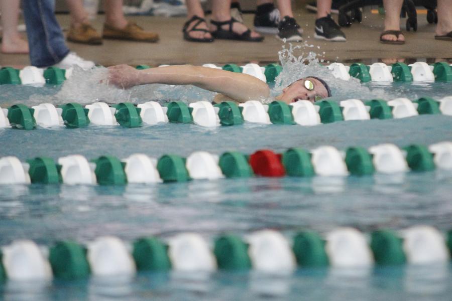 Swimming+the+500+yard+freestyle%2C+junior+Jordan+Robinson+takes+a+breath.