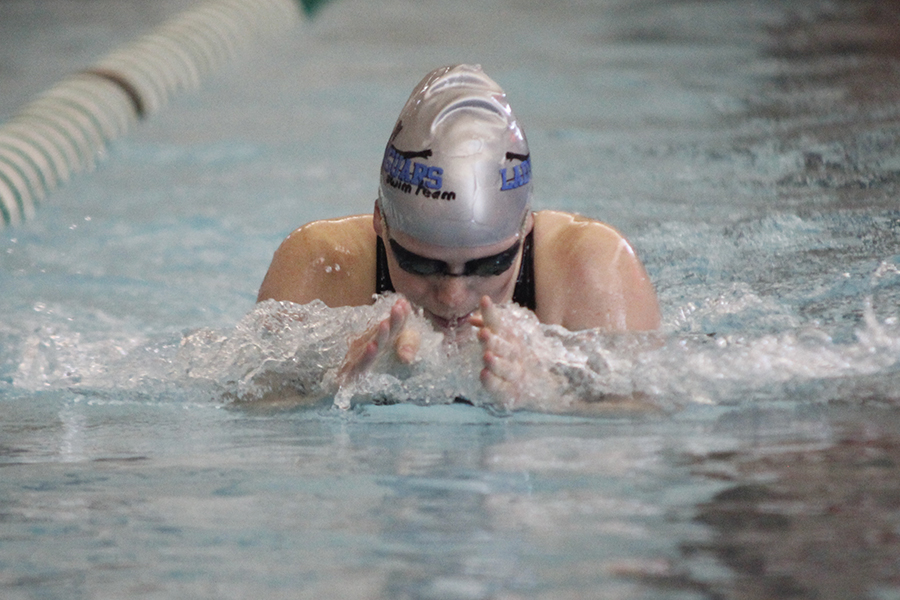 Freshman Kayla Teasley takes a breath before plunging her hands forward and continuing her stroke.
