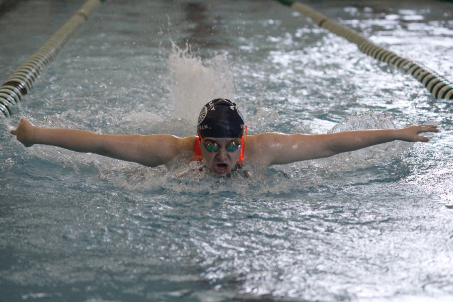 Freshman+Cadee+Morris+propels+her+self+forward+while+racing+in+the+100+yard+butterfly.