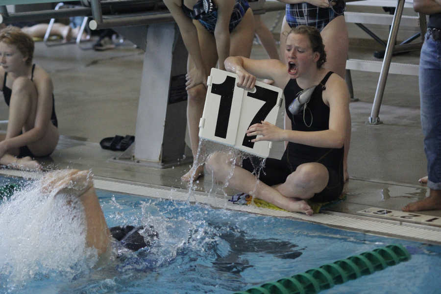 Freshman+Kayla+Teasley+cheers+and+counts+laps+for+her+teammate+during+the+500+yard+freestyle%2C