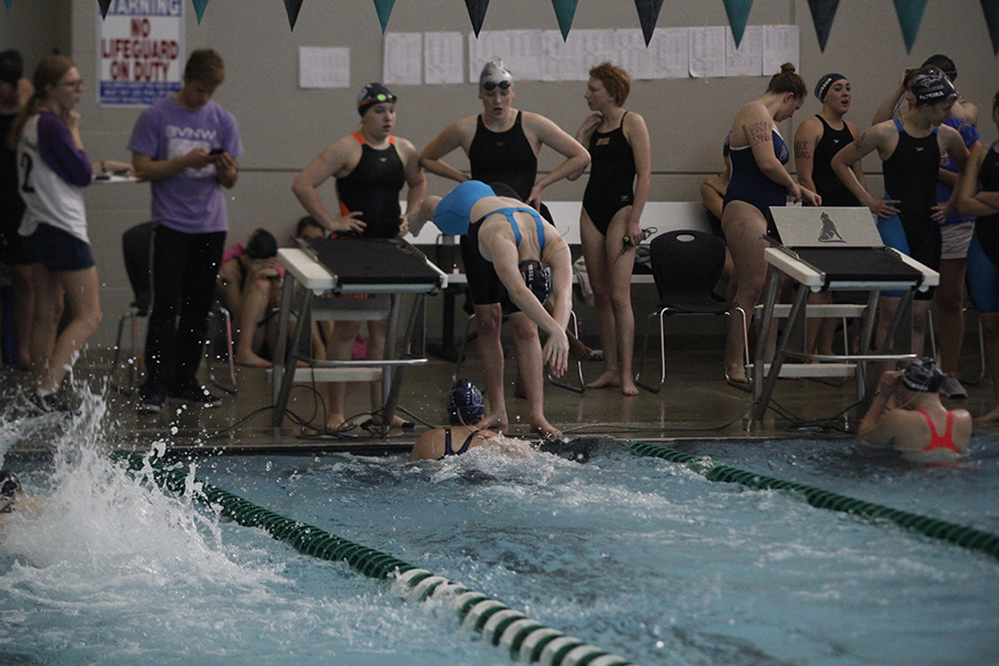 Freshman+Alison+Godfrey+dives+into+the+water+after+her+teammate+sophomore+Celia+Kistner+touches+the+wall.