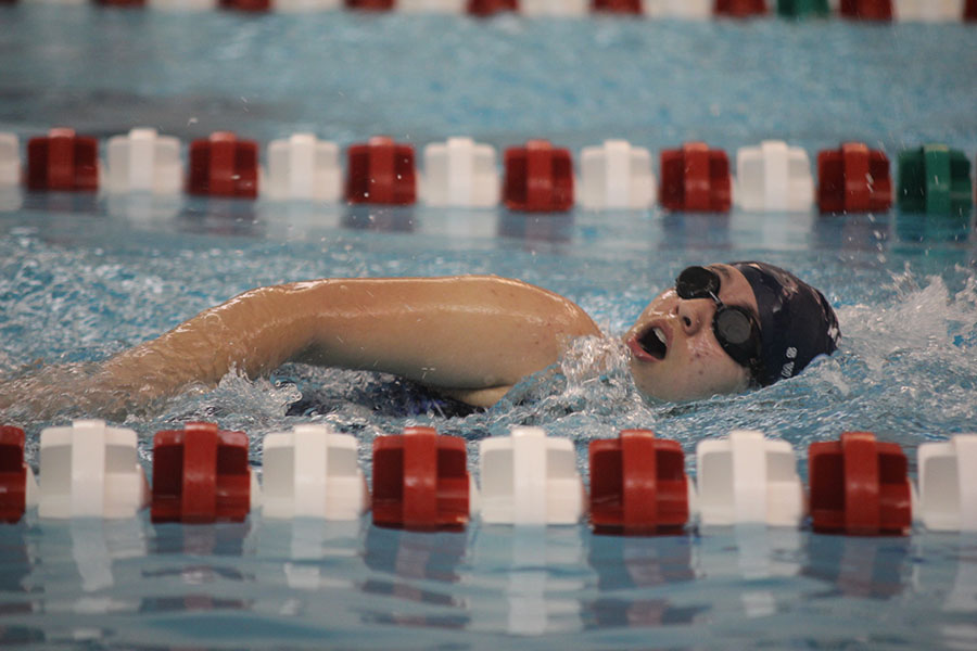 During a swim meet hosted by Blue Valley West on Tuesday, May 2, sophomore Lyrik Cooper swims in the freestyle event.