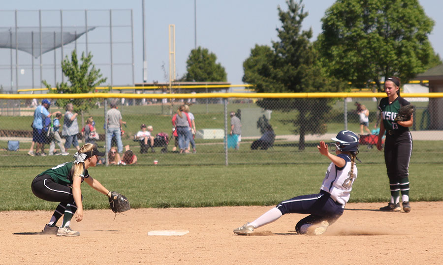 Sophomore+Haley+Puccio+holds+out+her+arms+to+steady+herself+as+she+slides+into+second+base.+