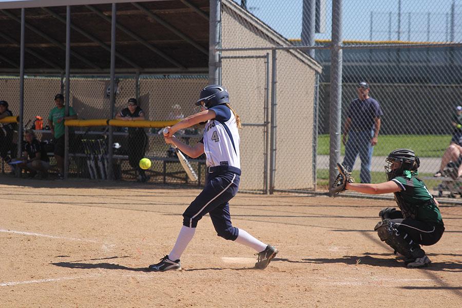 Swinging+her+bat%2C+junior+Sydney+Parker+prepares+for+it+to+meet+the+ball.++