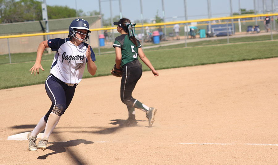 Sophomore+Haley+Puccio+rounds+third+and+sprints+to+home+base.