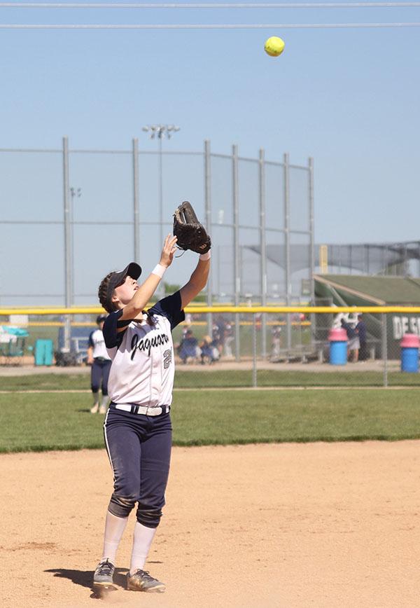 Sophomore+Grace+Lovett+holds+her+mitt+up+to+catch+the+ball.