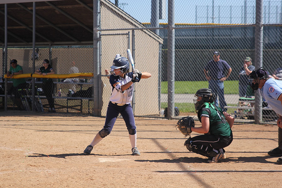 With+her+eyes+on+the+ball%2C+Sophomore+Payton+Totzke+prepares+to+hit+it.