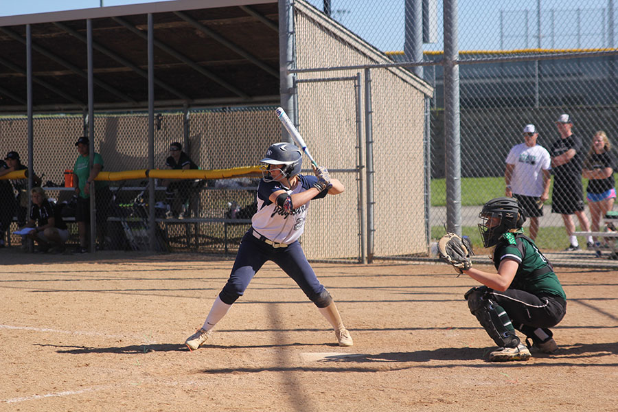 With+her+eyes+on+the+pitcher%2C+junior+Peyton+Moeder+gets+ready+to+hit+the+ball.+