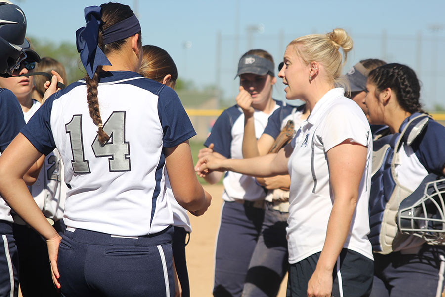 Coach+Jessica+DeWild+talks+with+the+team+between+innings.+