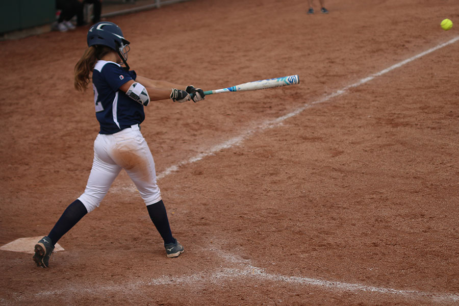 Sophomore+Payton+Totzke+hits+the+ball+after+it+was+pitched+to+her