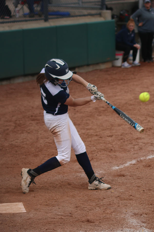 Standing+on+home+plate%2C+senior+Kristen+Kelly+hits+the+ball+after+a+pitch.