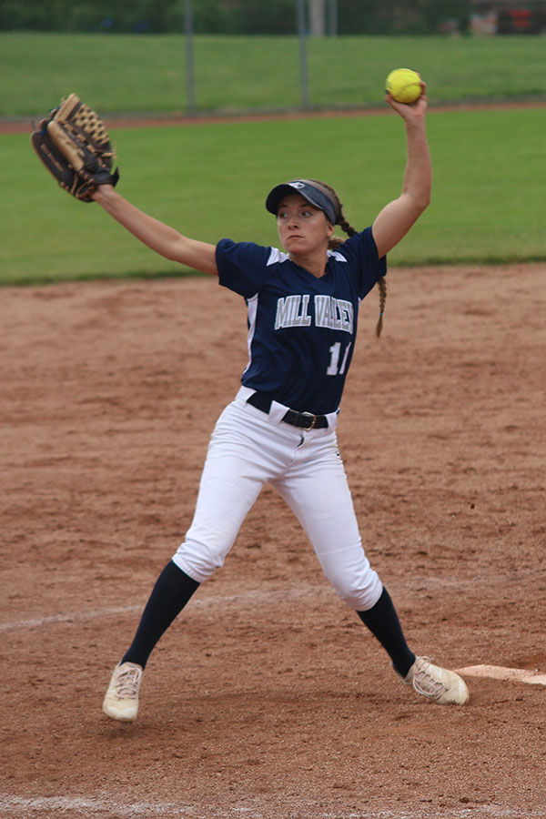 With+her+arm+and+ball+in+the+air%2C+senior+Shelby+Bonn+pitches+the+ball.