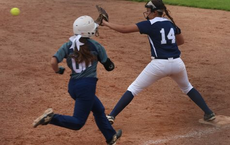 Standing on first base, freshman Lauren Florez looks to catch the ball so she can get an out