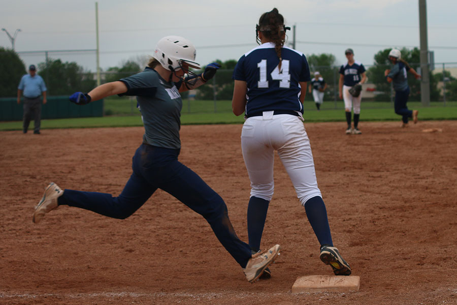 While+standing+on+first+base%2C+freshman+Lauren+Florez+looks+to+catch+the+ball+in+order+to+force+an+out