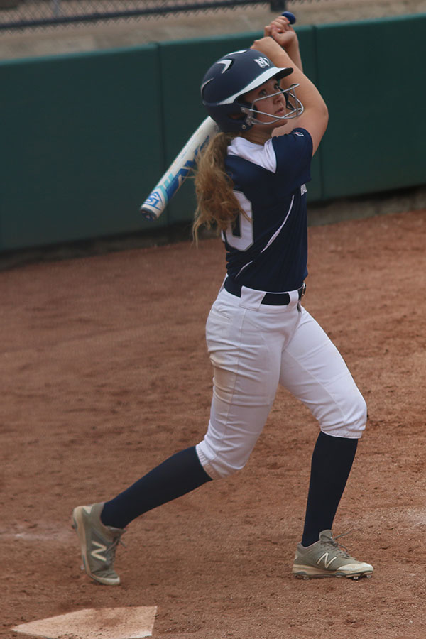 With+the+bat+in+the+air%2C+sophomore+Haley+Puccio+looks+to+see+where+the+ball+she+hit+went