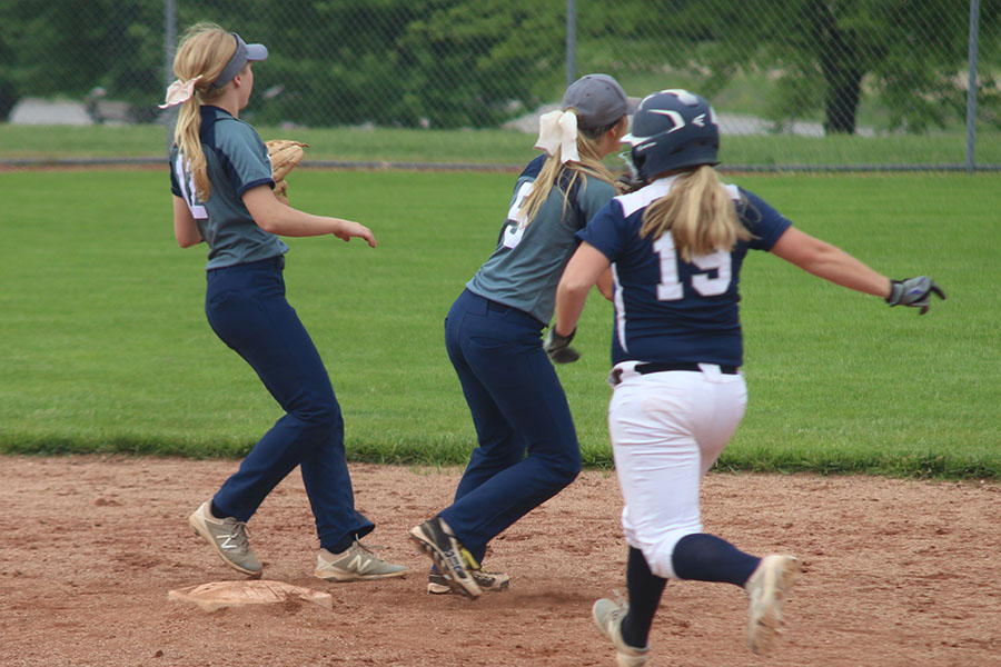 With+two+opposing+players+in+front+of+her%2C+senior+Grace+McGill+runs+to+touch+second+base