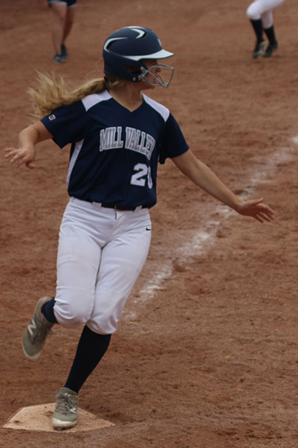 With+her+foot+on+home+plate%2C+sophomore+Haley+Puccio+scores+a+run+for+her+team