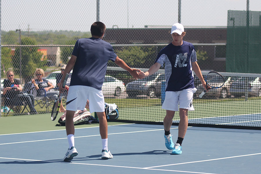 Senior+Alec+Bergeron+high+fives+his+doubles+partner+after+scoring+a+point.+