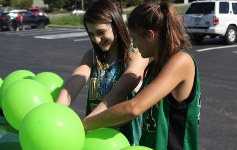 Before the annual homecoming parade on Wednesday, Sep. 6, Sophomores Grace Hanson and Abby Miller help decorate the sophomore class float.