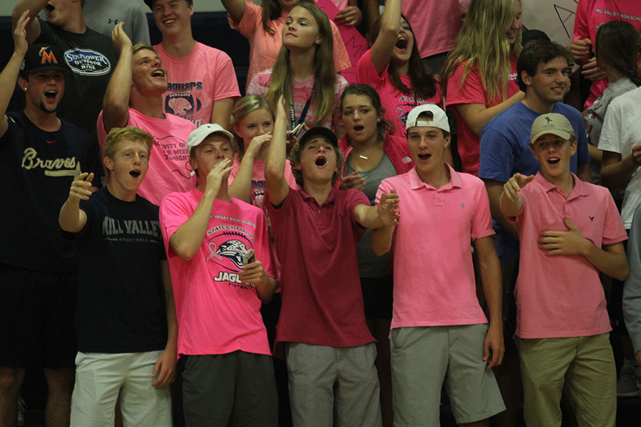 Senior+Colton+Hinkle+celebrates+with+other+members+of+the+student+section.