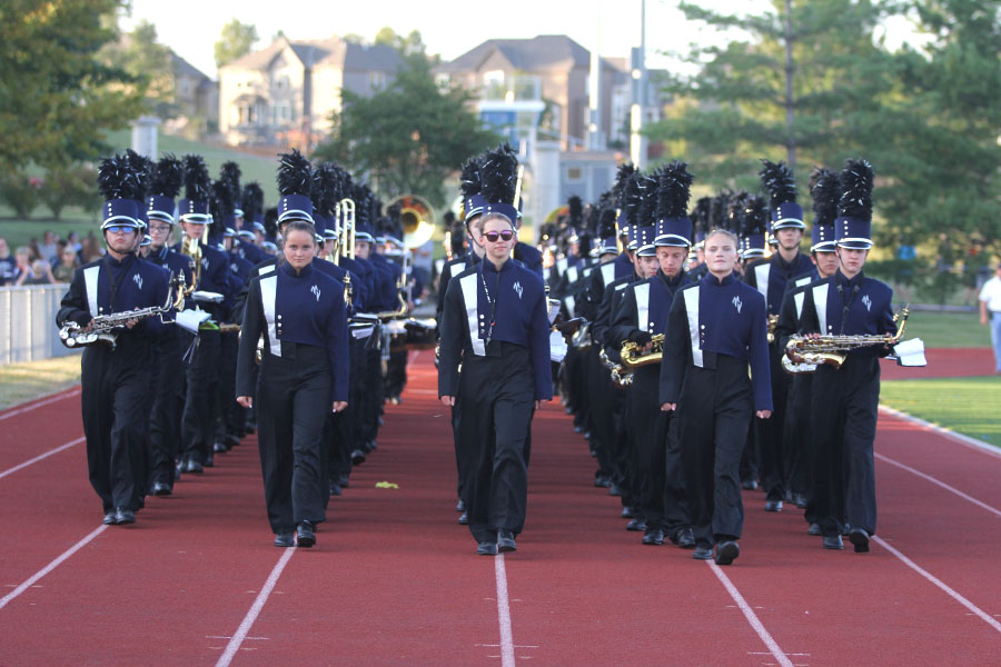 Before the homecoming football game on Friday, Sept. 8, the drum majors lead the band to the bleachers.