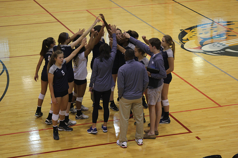 At+the+volleyball+game+on+Tuesday%2C+Sept.+12%2C+the+team+huddles+up+before+facing+Blue+Valley+West.