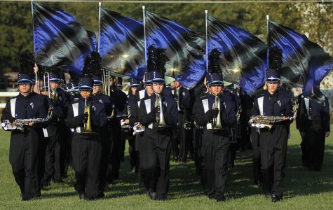 Walking from the practice field to the stadium, the marching band participates in the first band competition of the year at the Bonner Springs Marching Festival on Thursday, Sept. 21.