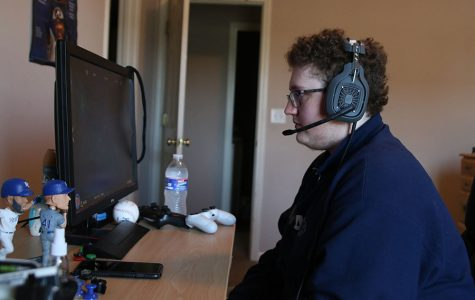 As he turns on his PlayStation, senior Shayne Howell gets ready to play video games.