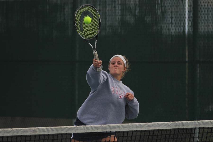 Senior+Peyton+Moeder+attacks+the+net+to+hit+the+ball+at+the+5A+Regional+Tennis+Tournament+on+Saturday%2C+Oct.+7.