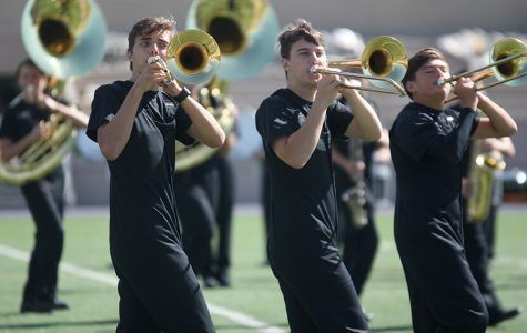 Performing for Kansas State band members, juniors Joe McClain and Johannes Seberger play their trombones at the clinic. The Marching Jaguars competed at the Central State Marching Festival on Saturday, Oct. 7, earning a superior one rating.
