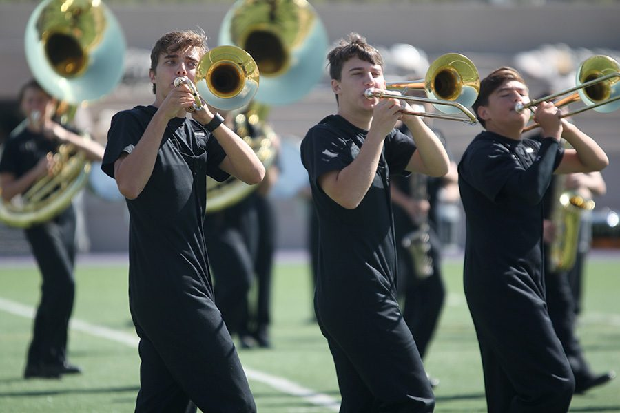 Performing+for+Kansas+State+band+members%2C+juniors+Joe+McClain+and+Johannes+Seberger+play+their+trombones+at+the+clinic.+The+Marching+Jaguars+competed+at+the+Central+State+Marching+Festival+on+Saturday%2C+Oct.+7%2C+earning+a+superior+one+rating.