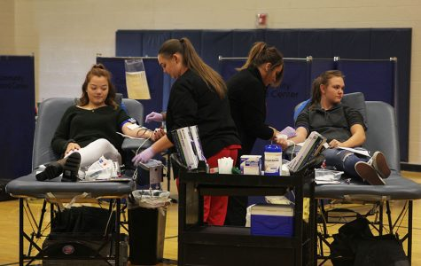 Nurses from the Community Blood Center take donations from junior Lauren Harris and sophomore Alison Wells on Thursday, Oct. 19