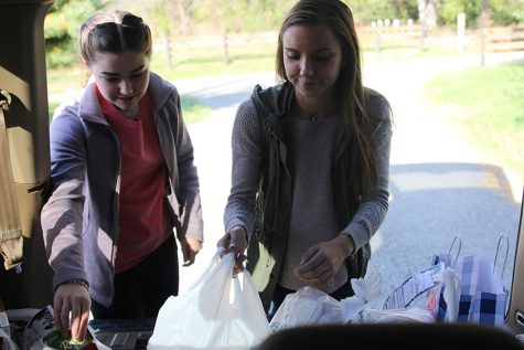 Students help community with 'Trick-or-Treat So Others Can Eat' event