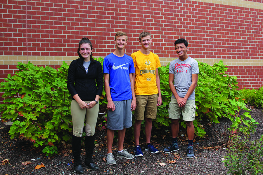 Using their burger expertise, junior Abby Hoepner, freshman Leif Campbell, senior Devin Mendenhall and sophomore Nico Gatapia taste four different burger patties from popular fast food chains in the Shawnee area on Sunday, Oct. 1.
