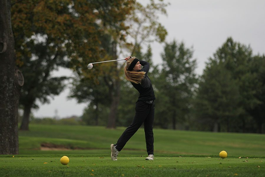 Using her driver, freshman Caroline Lawson hits the ball off the tee at the 5A regionals golf tournament on Tuesday, Oct. 10.
