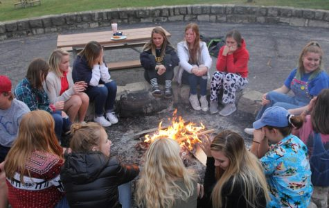 Gathered around the bonfire on Sunday, Oct. 29, members of MV Outfitters spend time with others who share a similar love of the outdoors.
