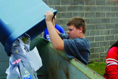 Students help out by picking up the school's recycling