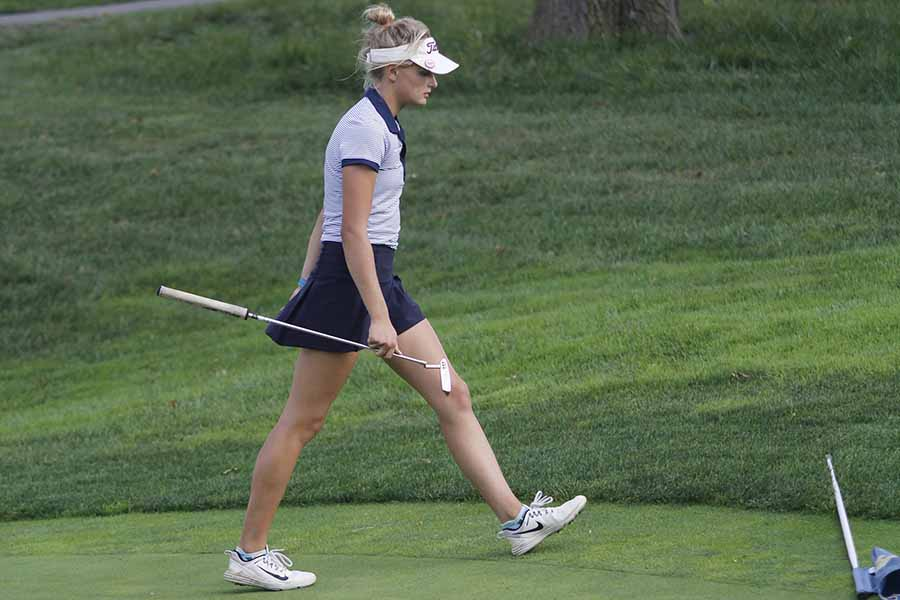 Senior Bella Hadden walks off after her putt at Lawerence Country Club golf course on Tuesday, Oct. 3.