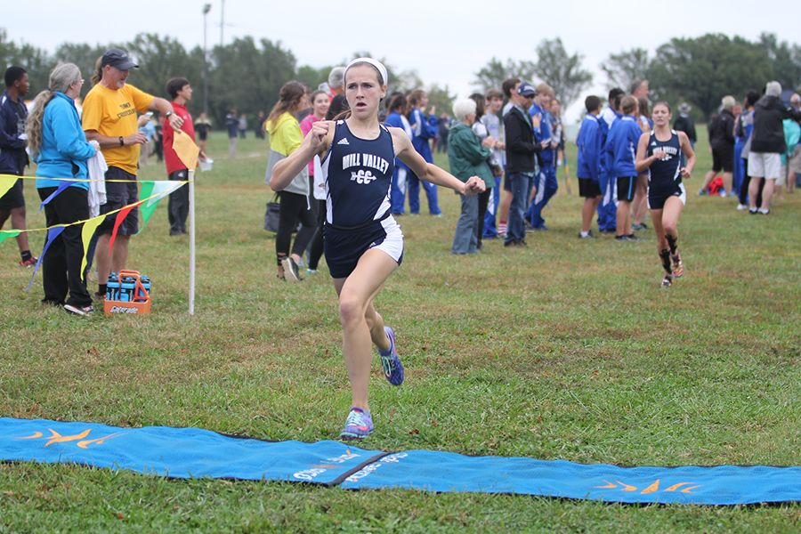 Crossing+the+finish+line%2C+sophomore+Morgan+Koca+wins+the+girls+varsity+race+at+the+Mark+Chipman+Cat+Classic+at+Shawnee+Mission+Park+on+Wednesday%2C+Oct.+4+
